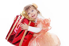 Little funny girl playing with gift box ribbon isolated on white Stock Photos