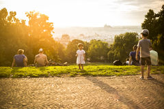 Little funny girl playing on green grass, Prague, august 2015 Stock Photos