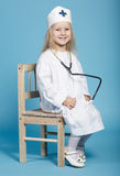 Little funny girl playing nurse. Photo of little funny girl playing nurse Stock Photo