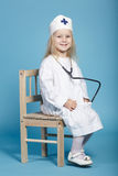 Little funny girl playing nurse. Photo of little funny girl playing nurse Royalty Free Stock Images