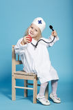 Little funny girl playing nurse. Photo of little funny girl playing nurse Stock Photography