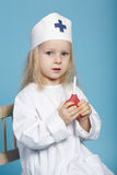 Little funny girl playing nurse. Photo of little funny girl playing nurse Stock Image
