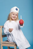 Little funny girl playing nurse. Photo of little funny girl playing nurse Stock Photos