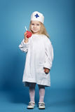 Little funny girl playing nurse. Photo of little funny girl playing nurse Royalty Free Stock Photography