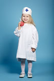 Little funny girl playing nurse. Photo of little funny girl playing nurse Royalty Free Stock Photos