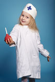 Little funny girl playing nurse. Photo of little funny girl playing nurse Royalty Free Stock Photo