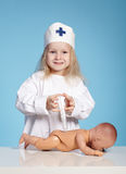 Little funny girl playing nurse. Photo of little funny girl playing nurse Royalty Free Stock Image