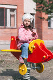 Little funny girl playing on the playground Royalty Free Stock Photo