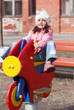Little funny girl playing on the playground Royalty Free Stock Image