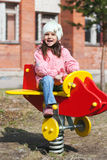 Little funny girl playing on the playground Stock Photos