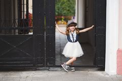 Little funny girl posing outdoors Royalty Free Stock Image