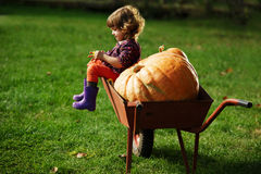 Little funny girl with pumpkins Royalty Free Stock Photos