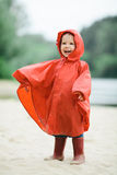 Little funny girl with raincoat Stock Photography