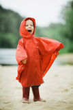 Little funny girl with raincoat Royalty Free Stock Photos