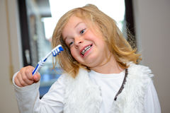 Little funny girl with retainer and toothbrush. Looking in to the camera stock photos