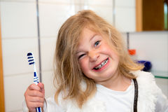 Little funny girl with retainer and toothbrush Royalty Free Stock Photography