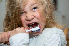Little funny girl with retainer and toothbrush Stock Images