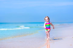 Little funny girl running on a beach Royalty Free Stock Images