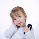 Little funny girl with two mobile phones. On white Stock Photography