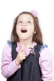 Little Funny Girl With Open Mouth Looking Up Royalty Free Stock Image