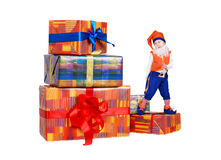 Little funny gnome dancing on gift boxes Stock Image