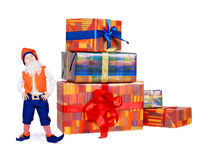 Little funny gnome with gift boxes 1 Stock Photography
