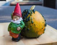 Little funny gnome sculpture thinking what to do Stock Photography