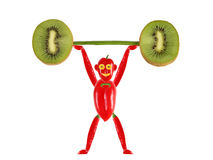 Little funny man made of pepper  raises bar. Stock Photo
