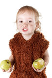 Little funny Neanderthal boy in a suit with dirty face eating an apple. Little funny Neanderthal boy in a suit with a dirty face eating an apple. Humorous Royalty Free Stock Photography