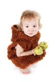 Little funny Neanderthal boy in a suit with dirty face eating an apple. Little funny Neanderthal boy in a suit with a dirty face eating an apple. Humorous Stock Image