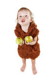 Little funny Neanderthal boy in a suit with dirty face eating an apple. Little funny Neanderthal boy in a suit with a dirty face eating an apple. Humorous royalty free stock photo