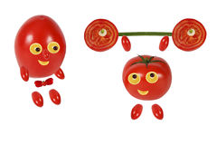 Little funny tomato raises the bar Stock Image
