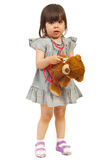Little future doctor girl with teddy bear Stock Images