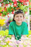 Little gardener. 9 years old boy in his flower garden - kids and family stock photo