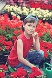 Little gardener. 9 years old boy in his flower garden - kids and family royalty free stock photos
