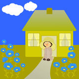 Little gardener. Standing in front of house and looking at flowers Royalty Free Stock Photo
