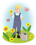 The little gardener. A little boy standing in a flower garden, at a watering can stock illustration