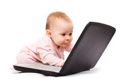 Little genius. Little computer genius baby girl with laptop royalty free stock images