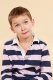 Little genius. Genius. Young caucasian boy thinking about a project isolated. Facial expressions concept stock photo