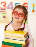 Little genius  with books Stock Photo