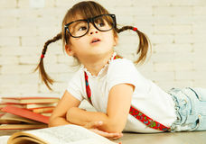 Little genius with books Royalty Free Stock Photo
