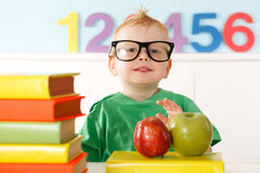 Little genius with books Royalty Free Stock Photos