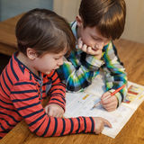 Little genius boy help his brother with homework Royalty Free Stock Photo