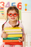 Little genius  with books Royalty Free Stock Images