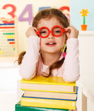 Little genius  with books Royalty Free Stock Photography