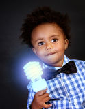 Little genius with illuminated lamp Royalty Free Stock Photo