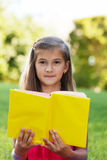 Little genius  with yellow book Stock Photography
