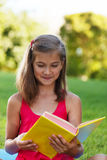Little genius  with yellow book Royalty Free Stock Image