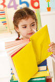 Little genius  with yellow book Royalty Free Stock Photo