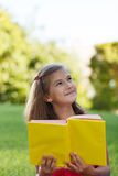 Little genius  with yellow book Stock Images